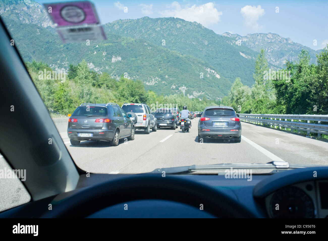 Traffic congestion on road leading to the Dolomite Mountains in Italy. - Stock Image
