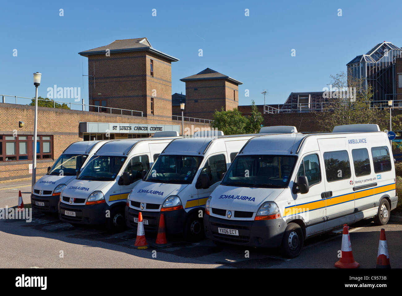 Four ambulances parked outside the St. Luke's Cancer Centre, Guildford - Stock Image