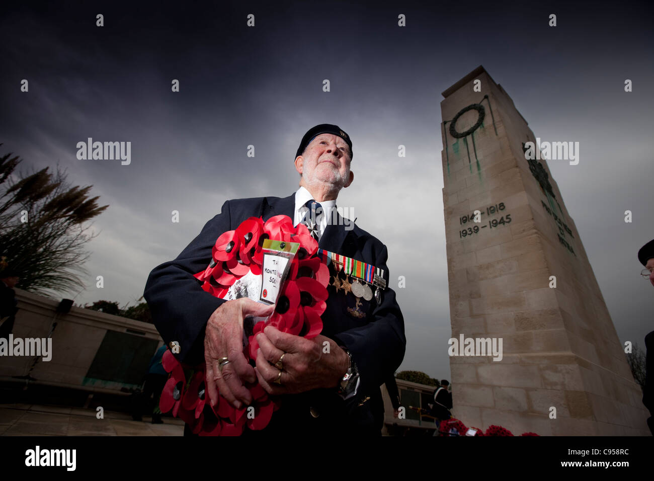 Veteran Harry Launder observes Armistice day at the Cenotaph in Swansea. - Stock Image