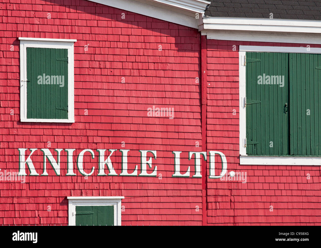 Red Building in Lunenburg. The bright red paint on the siding of the old Adams and Knickle building - Stock Image