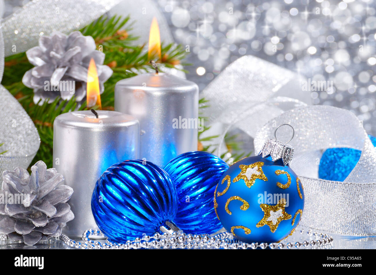 Blue Christmas Balls With Silver Candles Over Bright Background