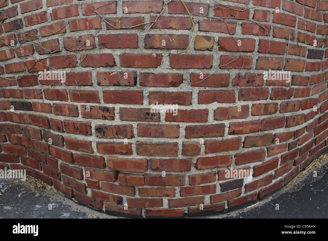 A warped looking brick wall. Stock Photo