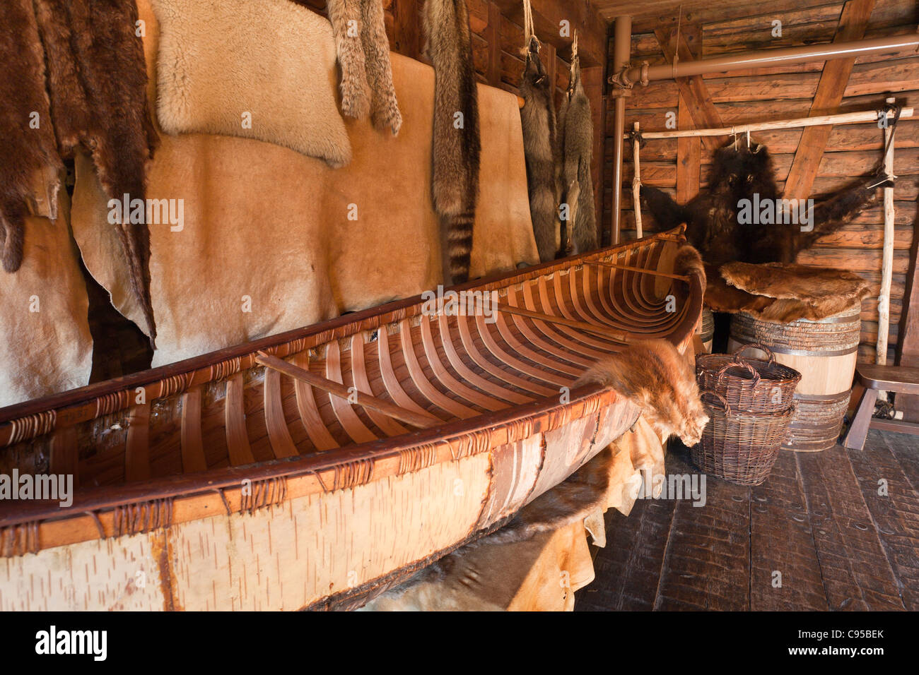 Canoe and Furs in a storage room at the Port Royal Habitation. The reconstructed Port Royal Habitation built in - Stock Image