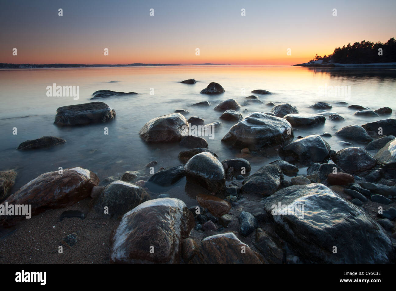 Coastal landscape at dusk at Oven, by the Oslofjord, in Råde kommune, Østfold fylke, Norway. - Stock Image