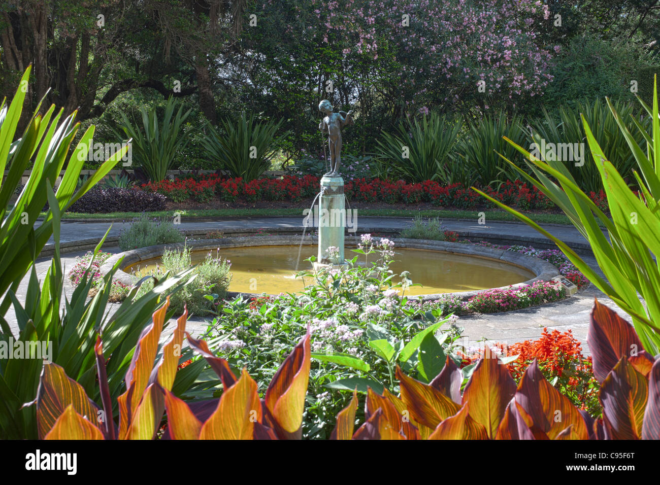 pond and fountain with statue of Cupid in Royal Botanic Gardens, Sydney, Australia - Stock Image