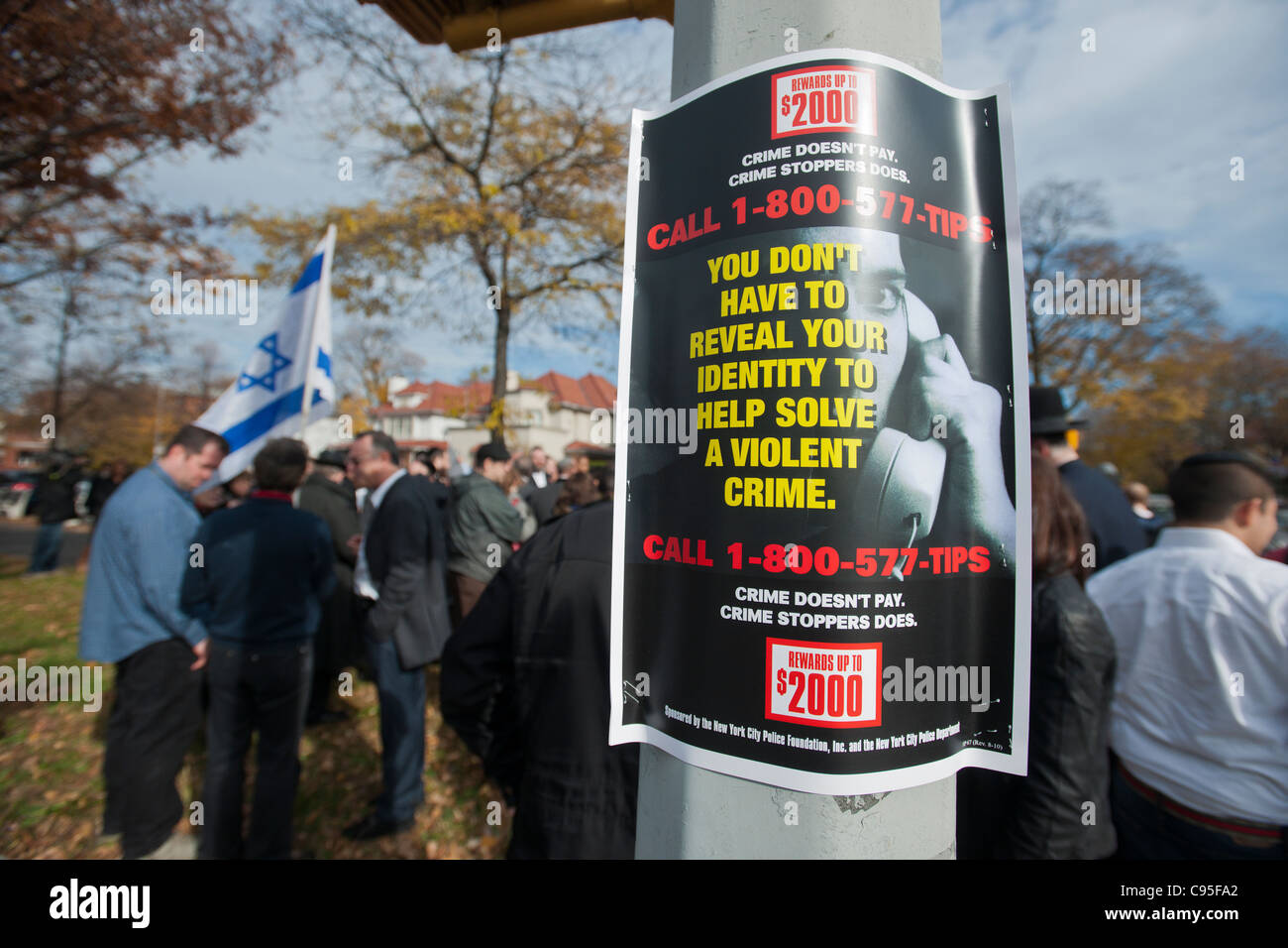 A Crime Stoppers reward poster on a lamp post prior to a march down Ocean Parkway in the Midwood neighborhood of - Stock Image