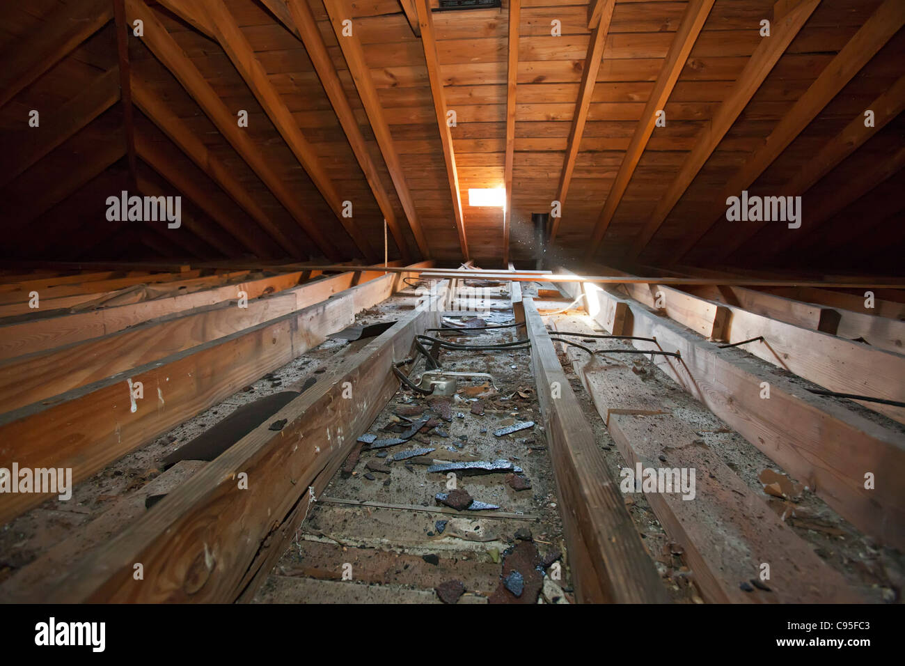 An uninsulated attic. - Stock Image