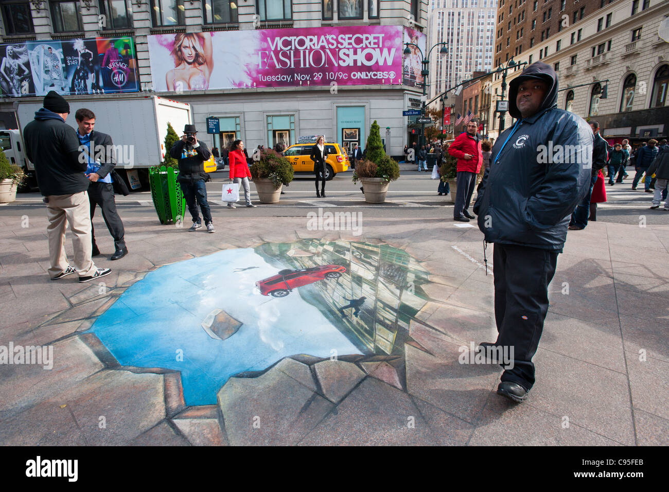 A chalk drawing on the sidewalk in Herald Square in New York is used as a promotion for General Motors' Chevrolet - Stock Image