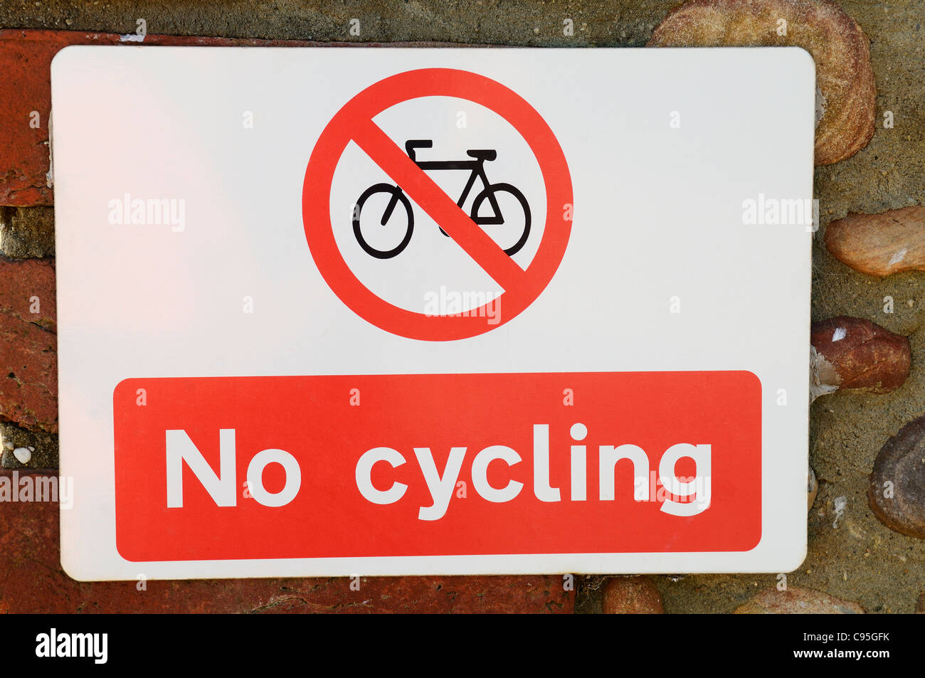 A No Cycling sign on a wall. - Stock Image
