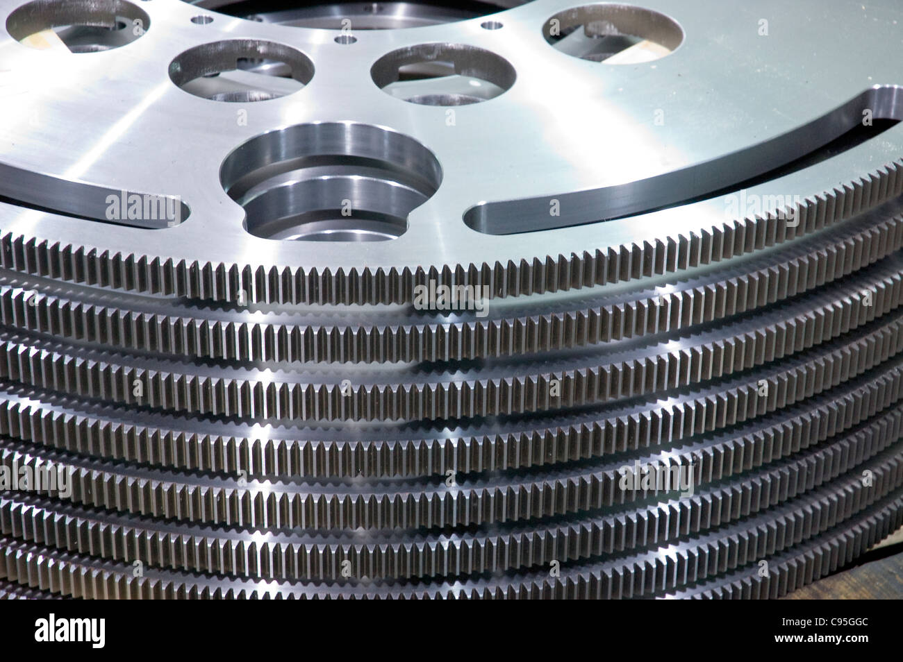close up stack of steel metal industrial gears - Stock Image
