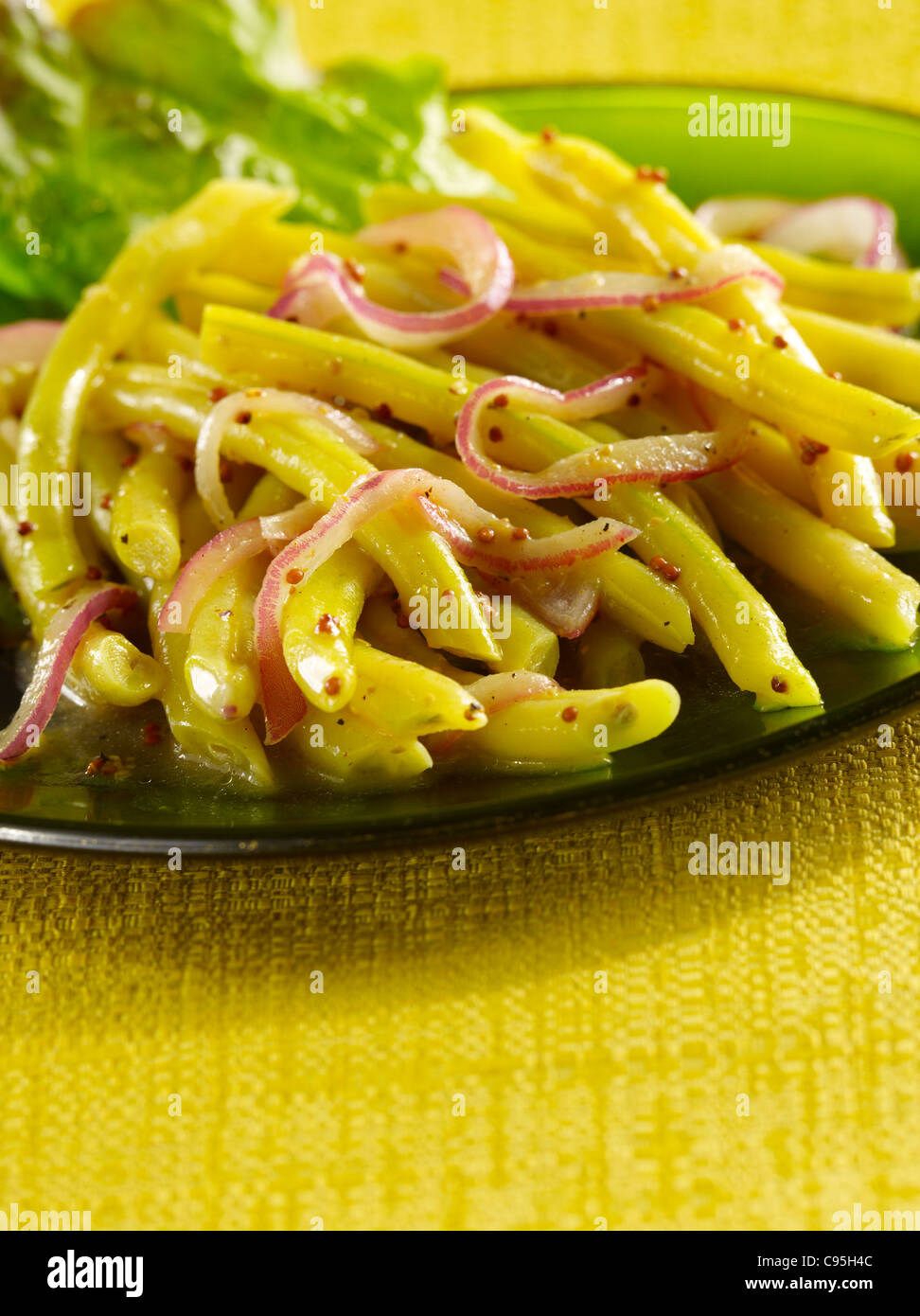 Yellow wax bean salad with onions - Stock Image