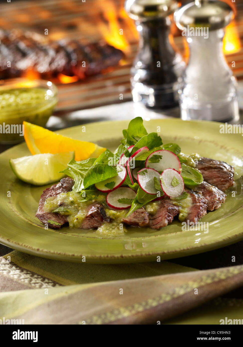Grilled skirt steak salad with a barbecue flame - Stock Image