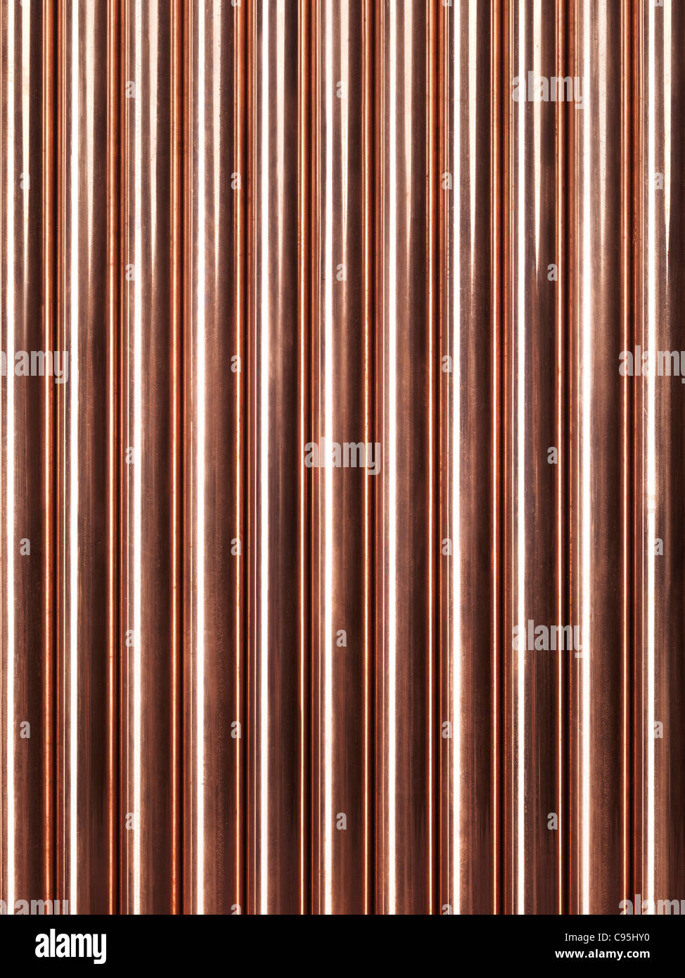 Shiny plumbing copper tubes abstract artistic background - Stock Image
