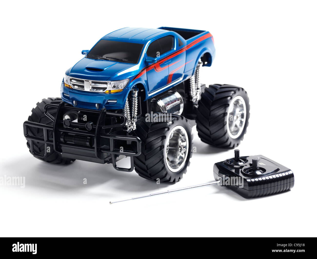 Radio controlled toy monster truck with a remote control isolated on white background - Stock Image