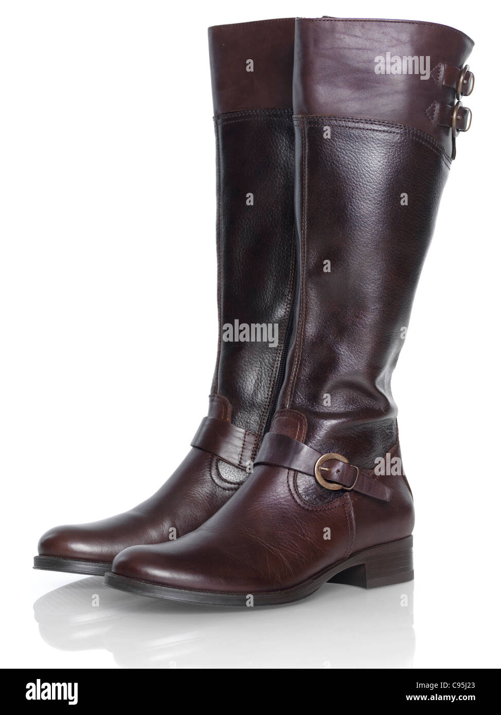 Knee-length brown leather fashion womens boots isolated on white background - Stock Image