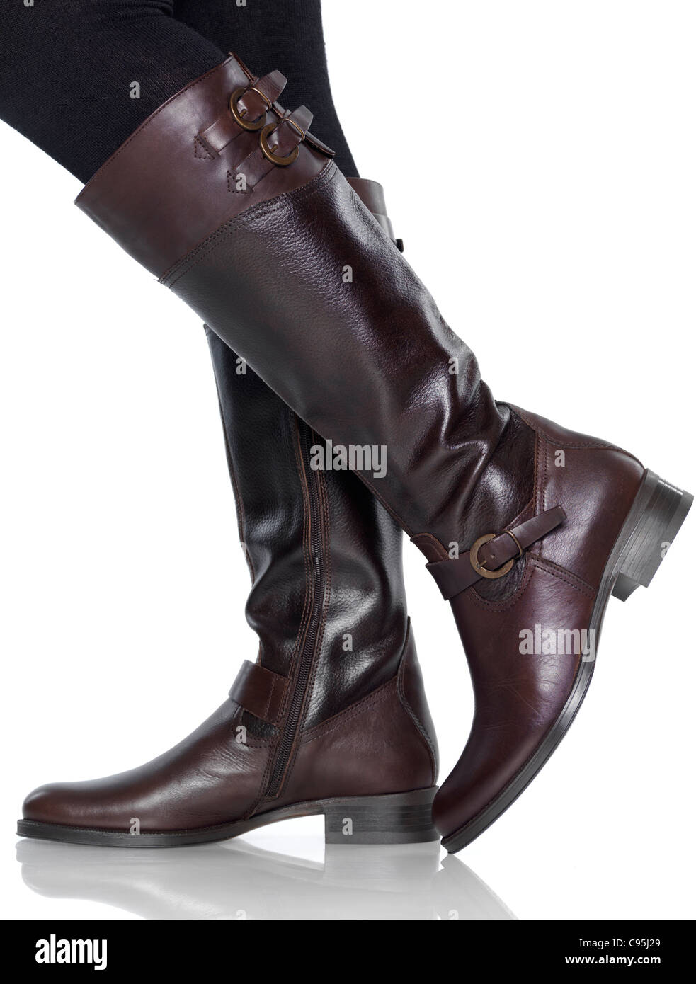 Woman Wearing Knee Length Brown Leather Fashion Boots Isolated On