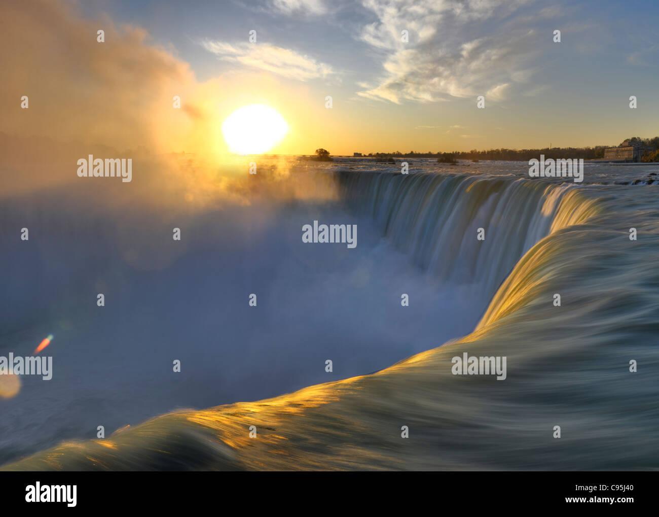 Brink of Niagara Falls Canadian Horseshoe during sunrise. Niagara Falls Ontario Canada. - Stock Image