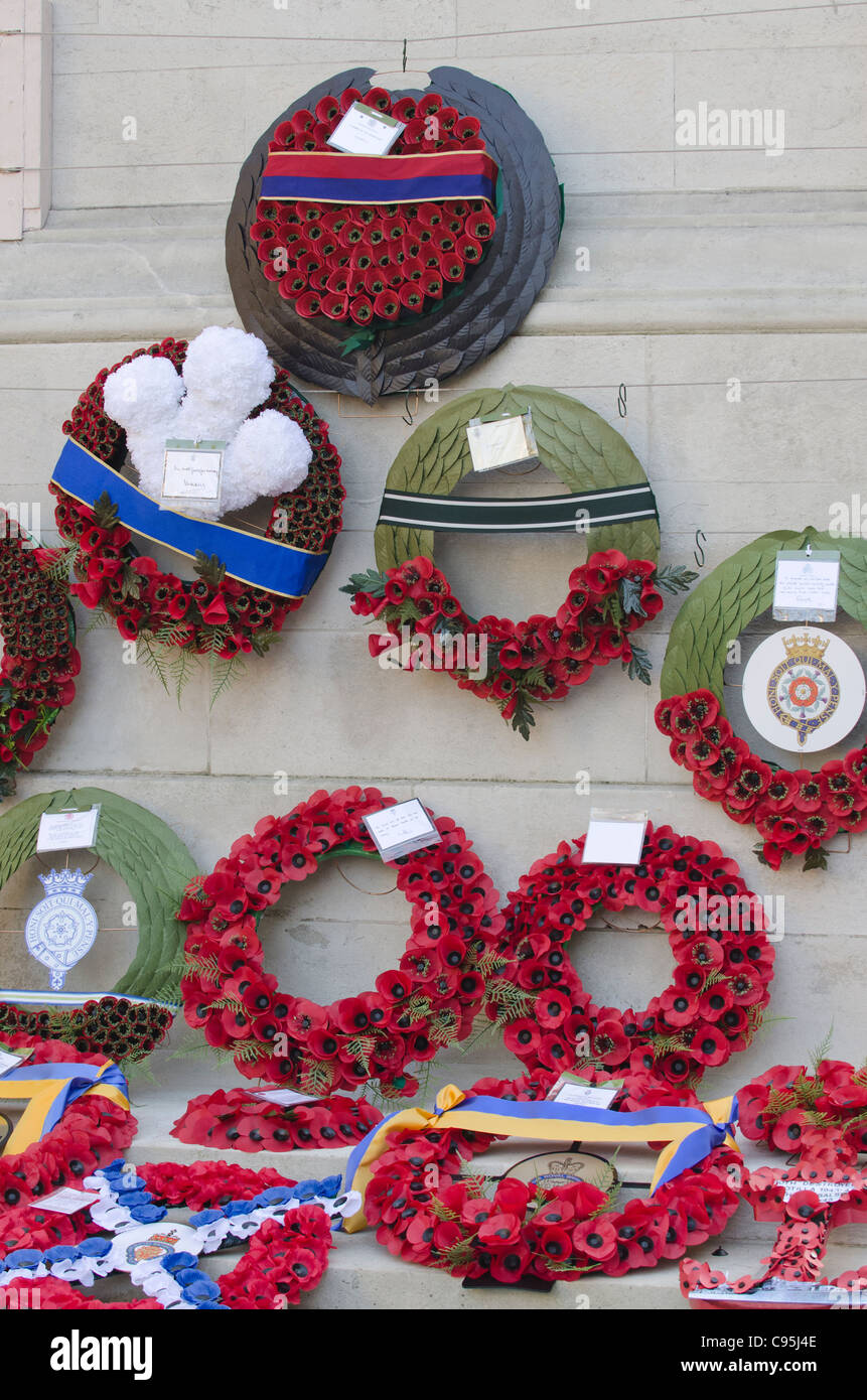 Royal Poppy wreaths around the Cenotaph Whitehall London UK Remembrance Sunday  2011. Top is from The Queen. - Stock Image