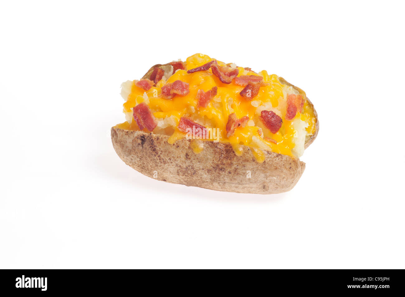 Baked potato topped with melted cheese and bacon bits on white background cutout. - Stock Image