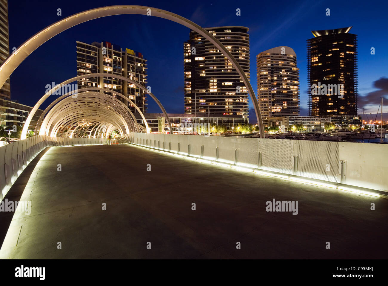 The Webb Dock Bridge in Melbourne's Docklands - its design inspired by Koorie fishing traps. Melbourne, Victoria, - Stock Image