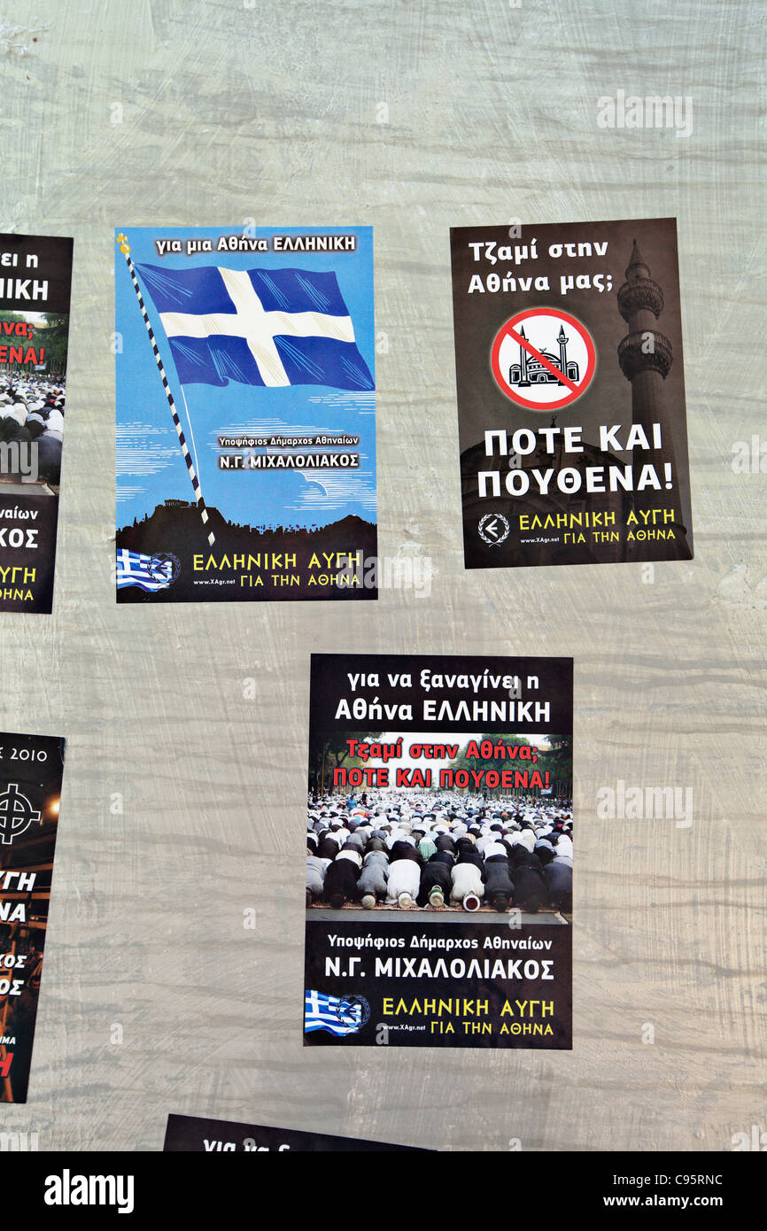 Racist (ultra nationalist) posters in Athens, Greece. - Stock Image