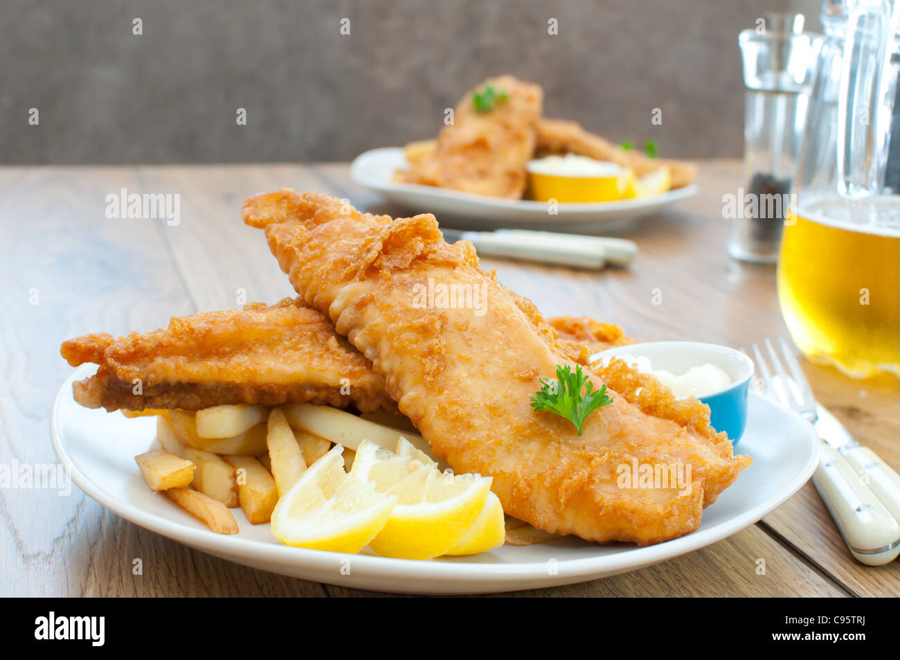 Fried fish fillets with chips - Stock Image