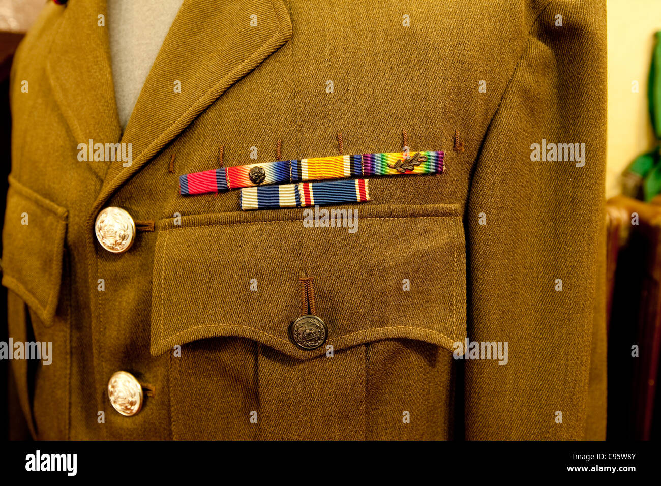 A British Military dress Uniform displaying colours or silks to describe medal awards for gallantry or campaigns. - Stock Image
