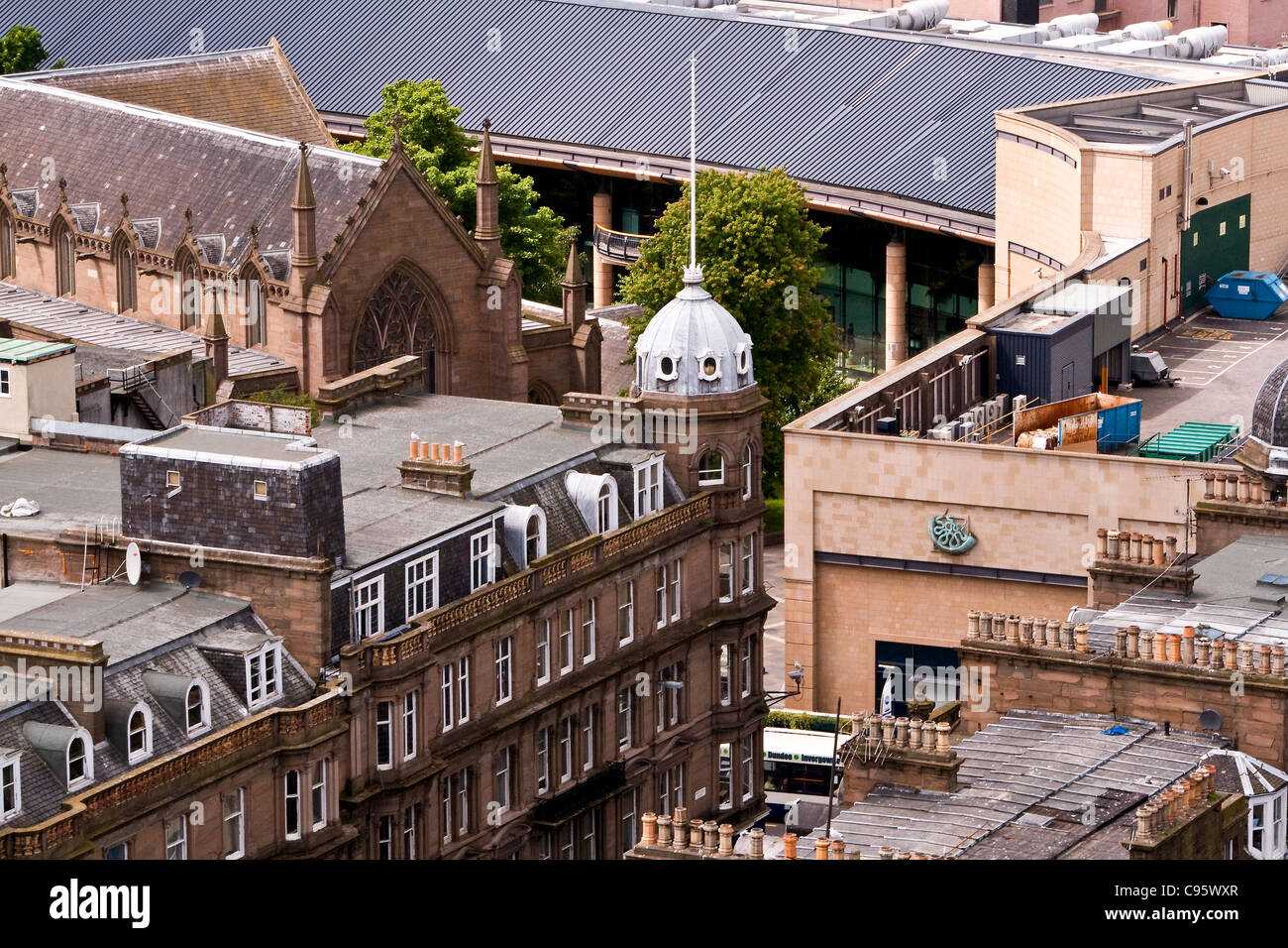 Ariel view of rooftops of buildings in central Dundee including the modern Overgate shopping mall and the old Steeple Stock Photo