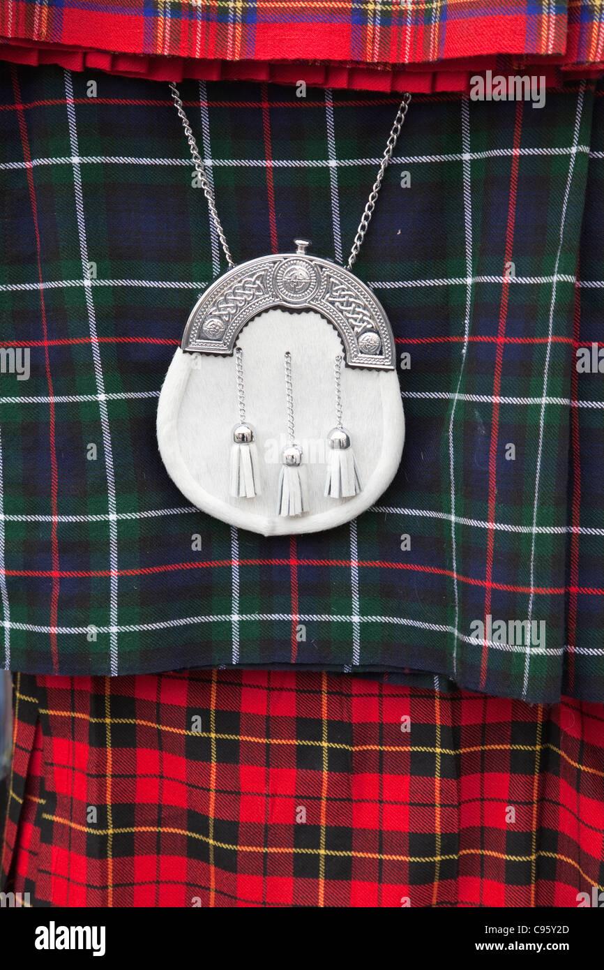 Scotland, Edinburgh, The Royal Mile, Souvenir Shop Display of Scottish Kilt and Sporran - Stock Image