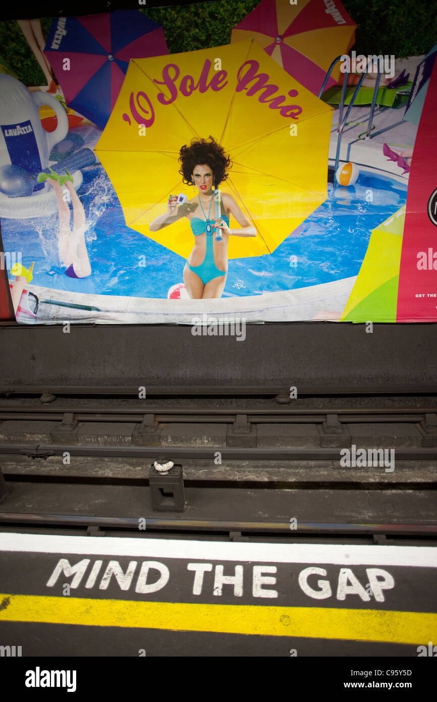 England, London, Underground Station Sign and Advertising Poster Stock Photo