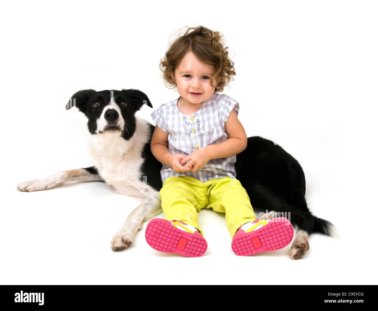 Toddler and her pet dog. - Stock Image