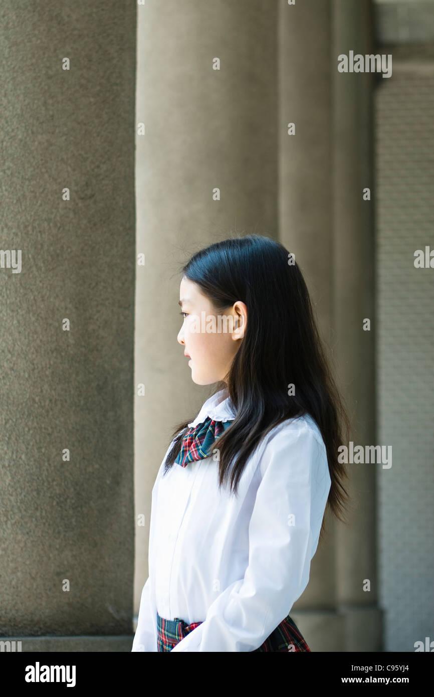 asian schoolgirl in school uniform - Stock Image