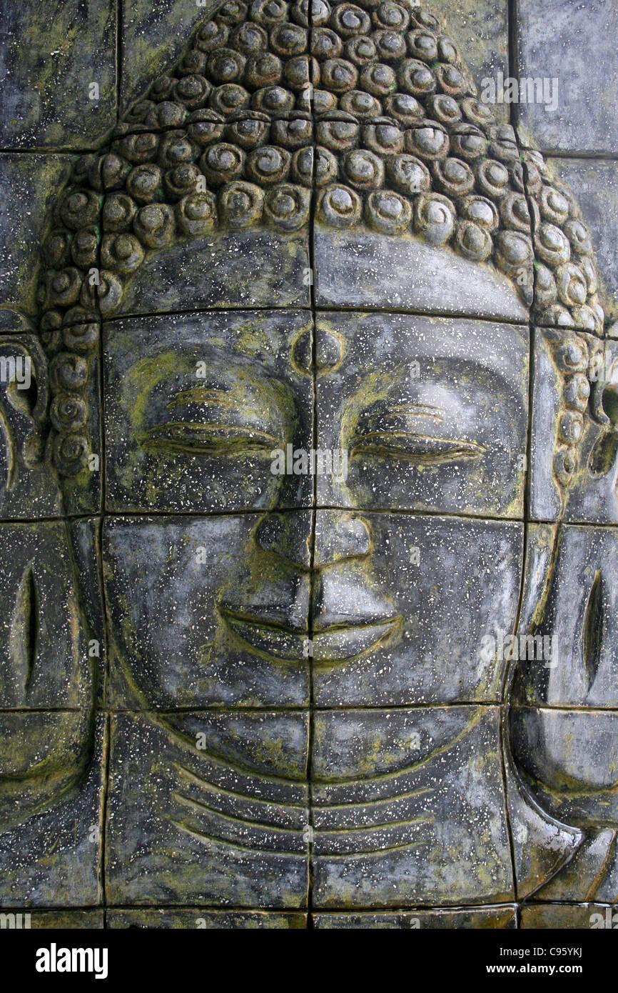 Stone Carved Buddha Wall Panel - Stock Image