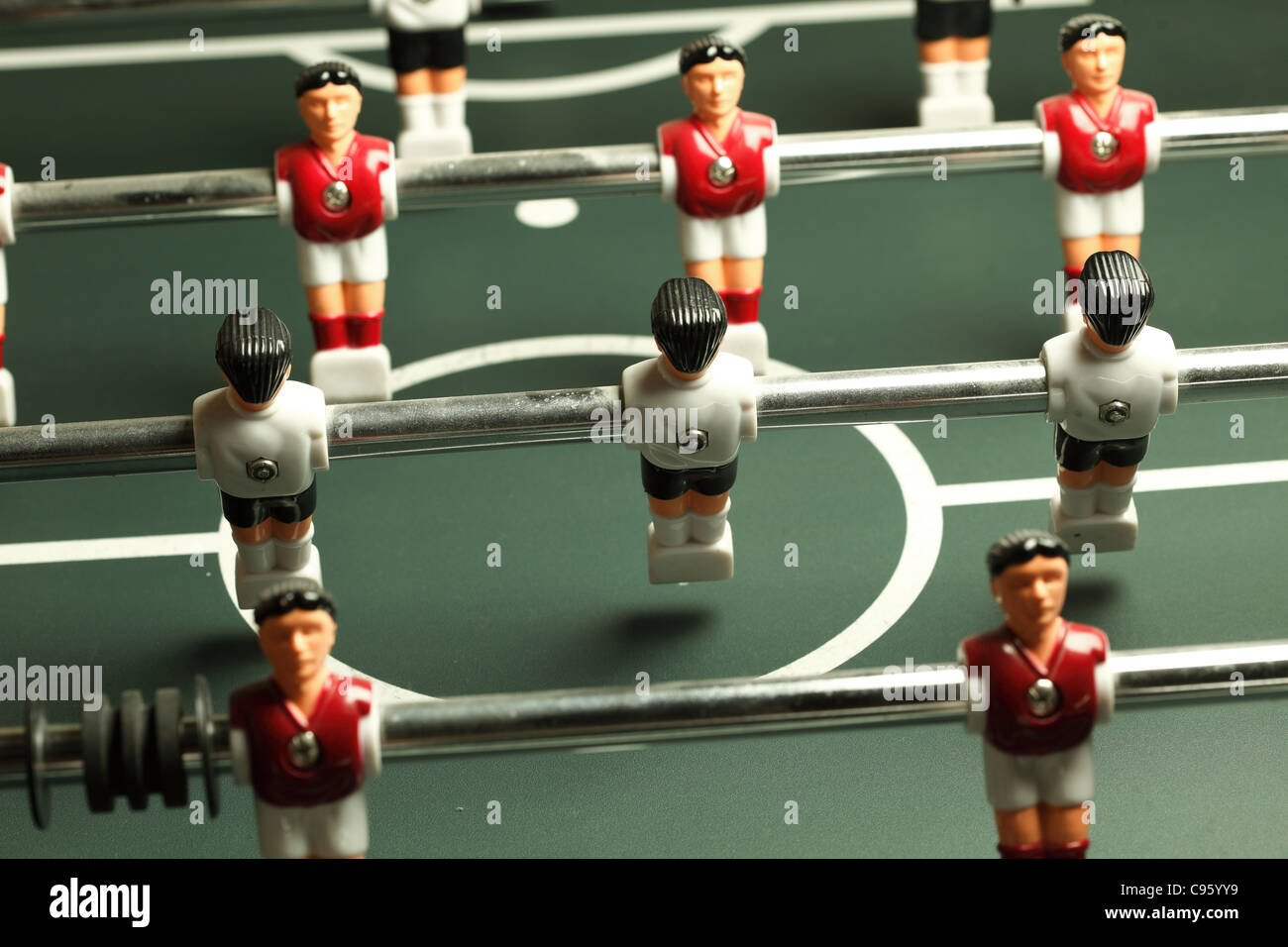 Table football game, Soccer table with red and blue players - Stock Image