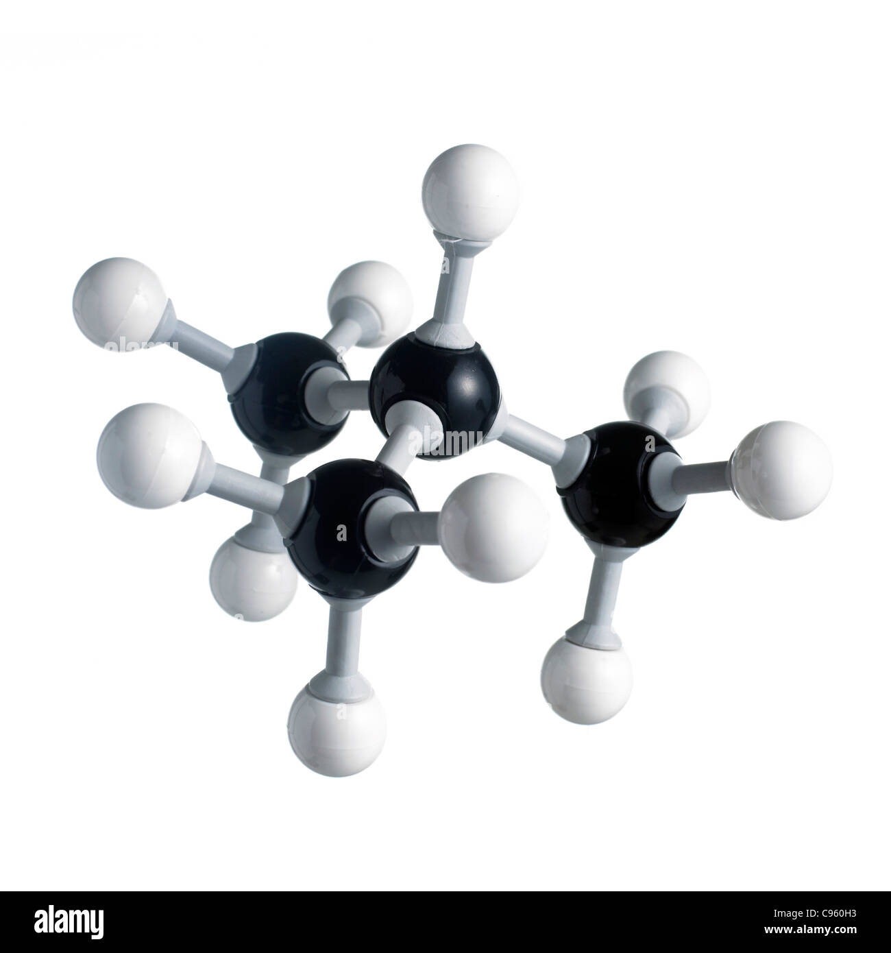 Isobutane molecule. Atoms are represented as spheres and are colour-coded: carbon (black) and hydrogen (white). - Stock Image