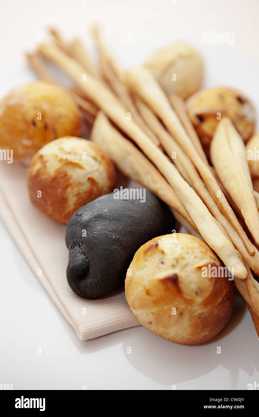 Bread dyed with octopus ink in Sicily, Italy. - Stock Image