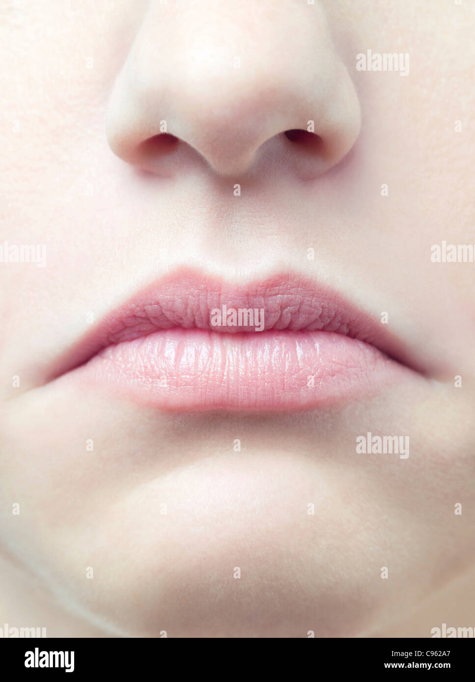 Unhappy woman's mouth. - Stock Image
