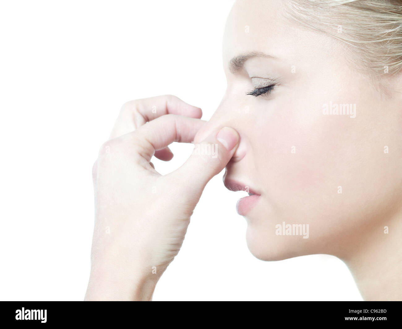 Woman holding her nose. - Stock Image