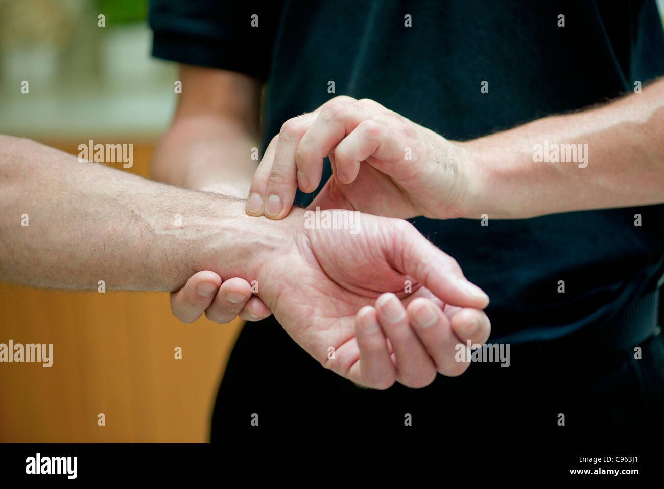 Taking a pulse. - Stock Image