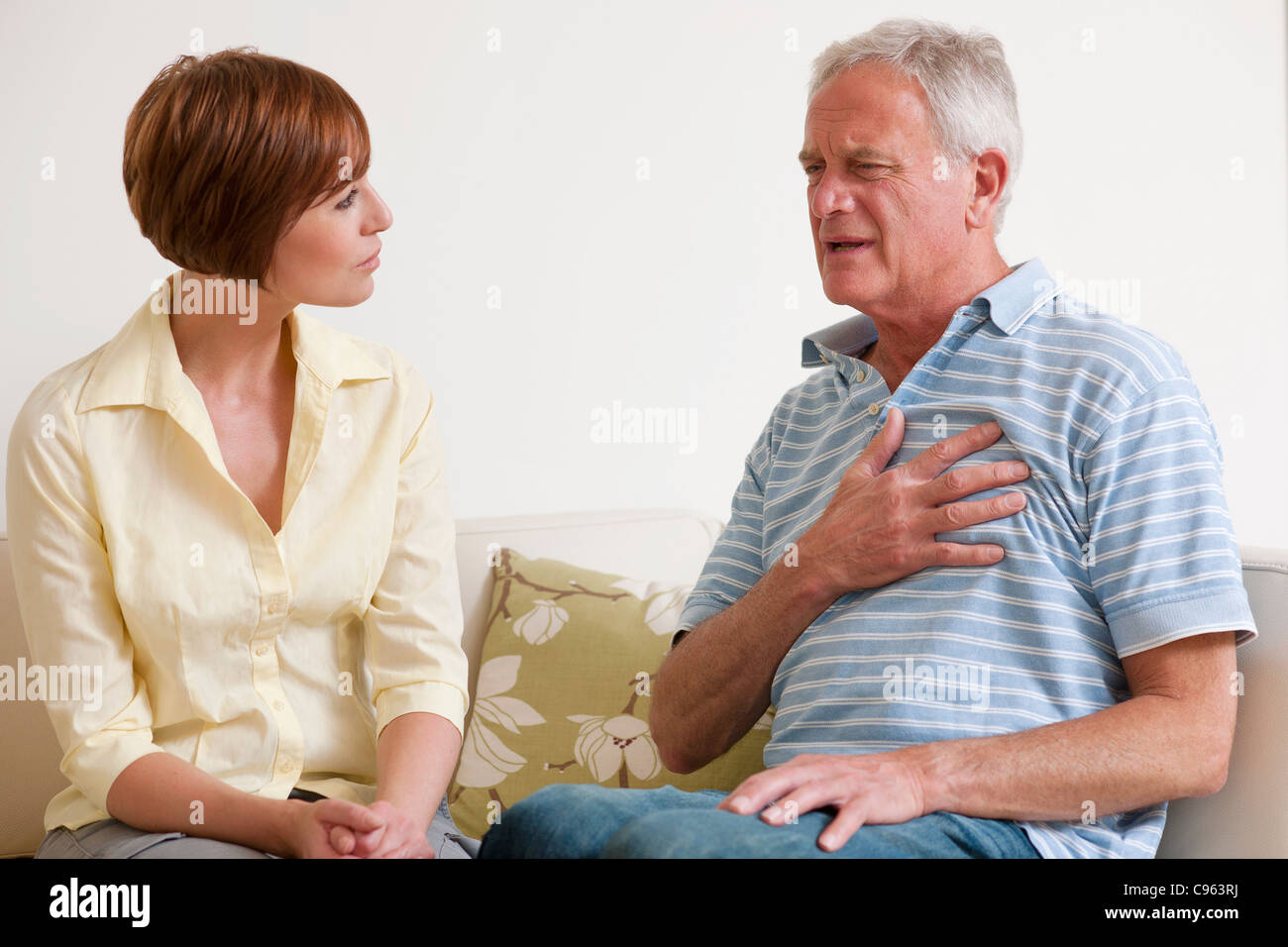 Man having a heart attack. - Stock Image