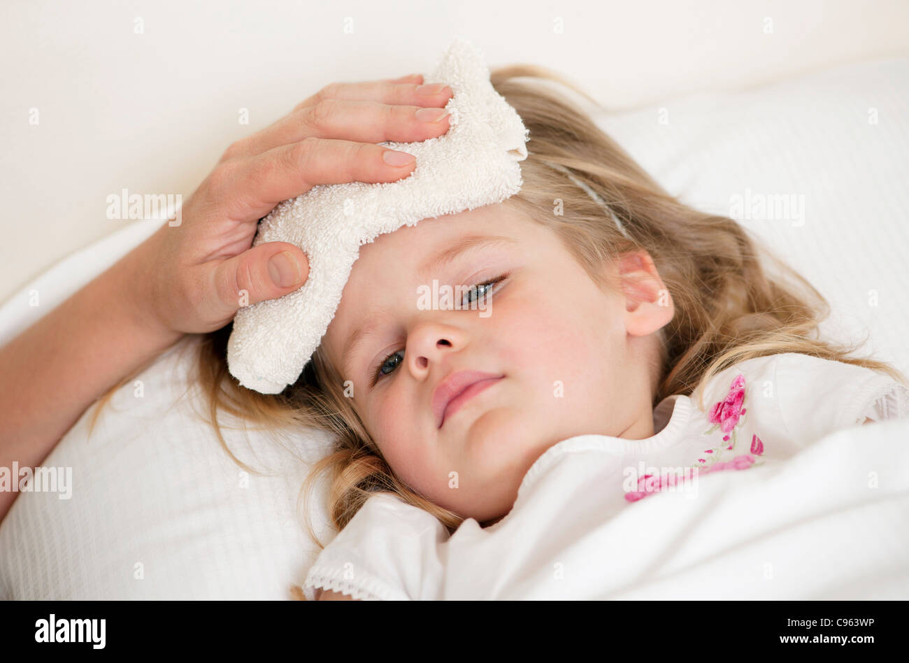 Soothing a child's fever. - Stock Image
