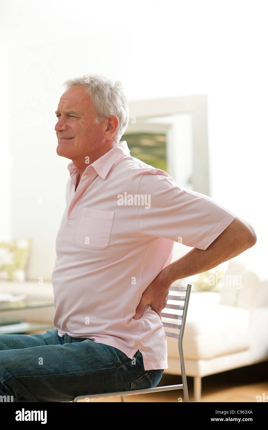 Man with lower back pain. - Stock Image