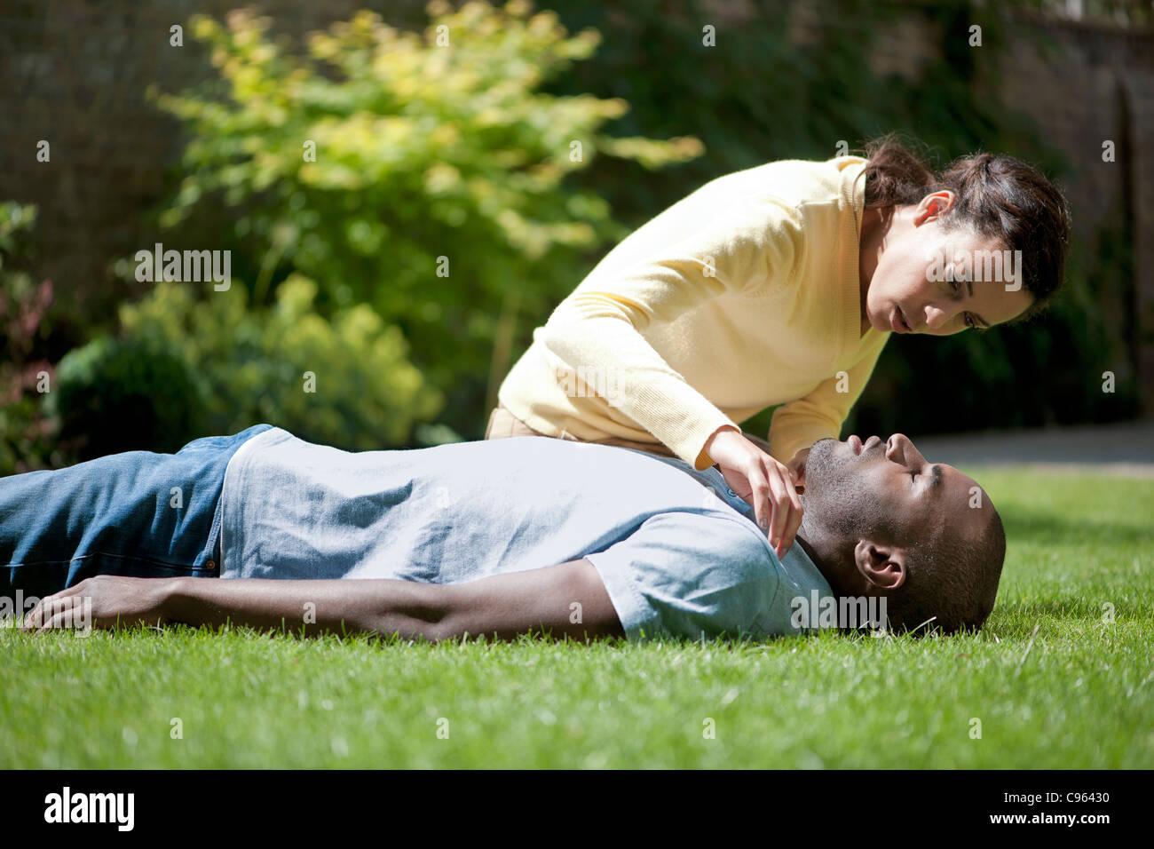 Adult cardiopulmonary resuscitation (CPR) - Stock Image