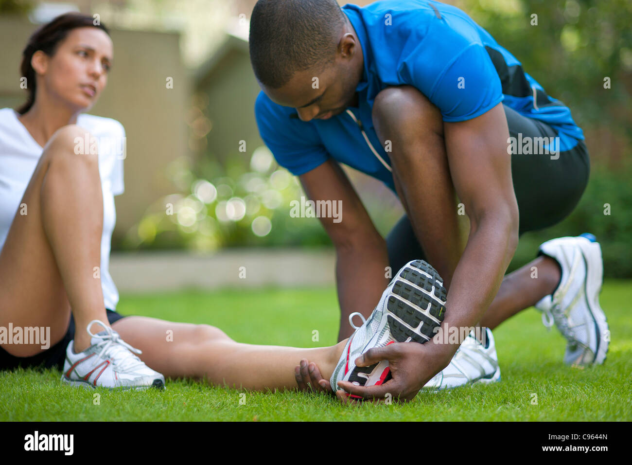 Ankle injury. Female runner with an ankle injury. - Stock Image