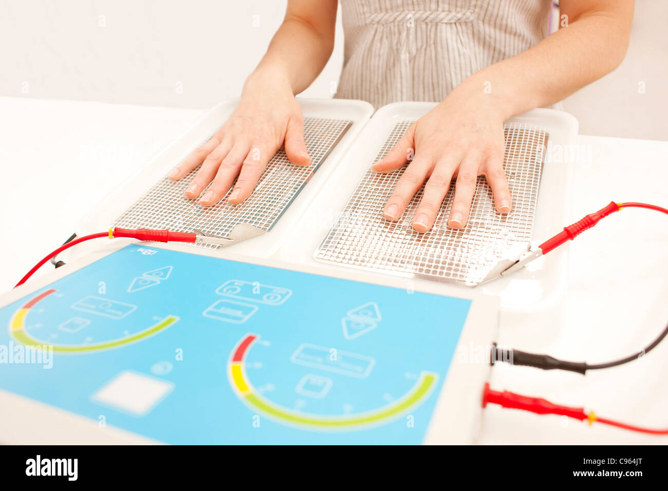 Iontophoresis. This is a treatment for excess sweating of the hands. - Stock Image