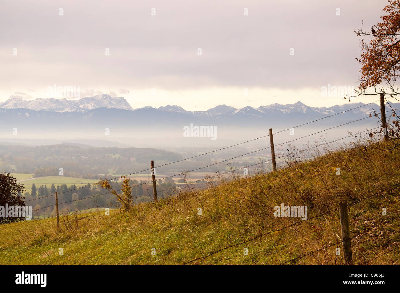 View from the bavarian alpine upland to the Alps in early fall - Stock Image