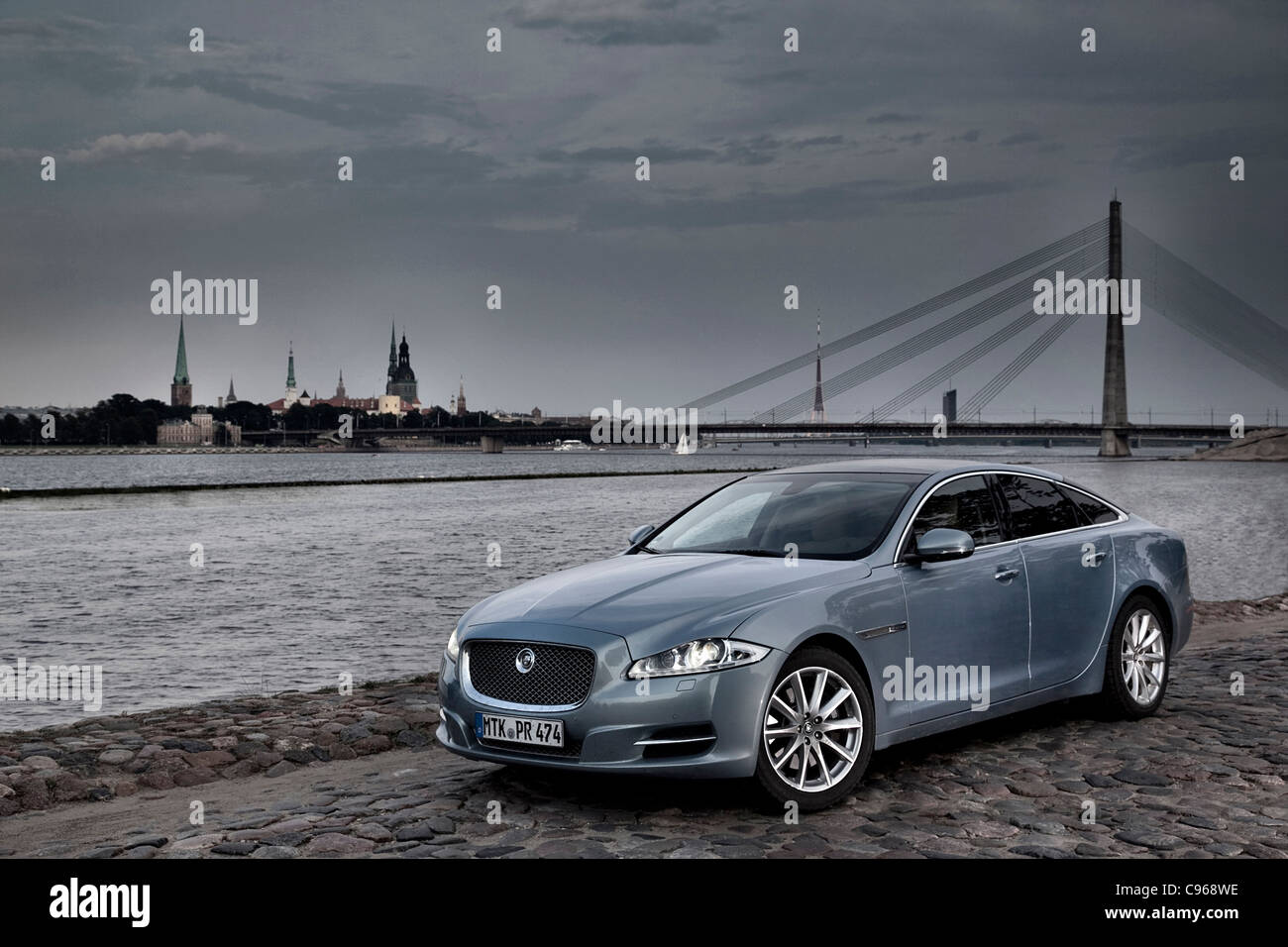 Jaguar XJ on the riverside in Riga Latvia - Stock Image