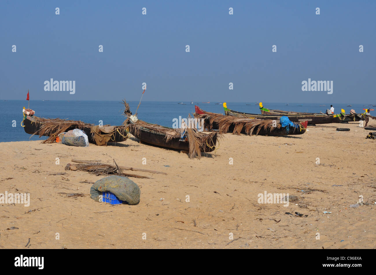 wooden country fishing boats parked on the beach - Stock Image