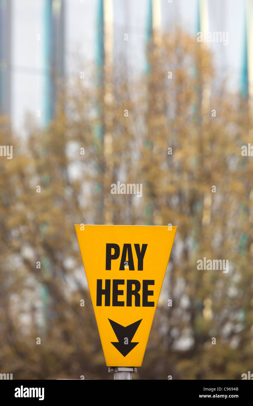 Pay Here car park sign . parking charges fee Stock Photo