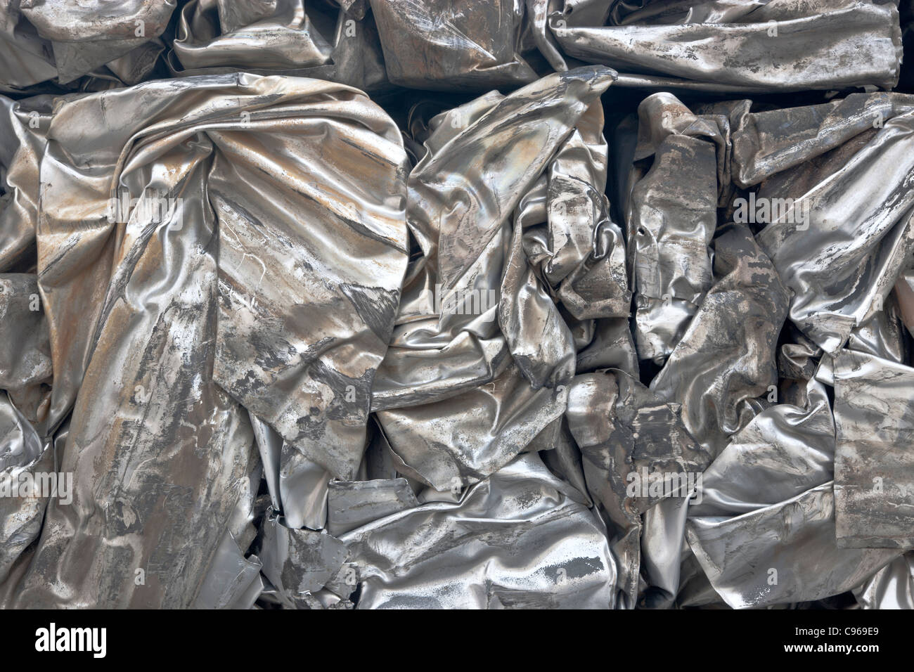 Recycling, compacted stainless steel sheeting - Stock Image